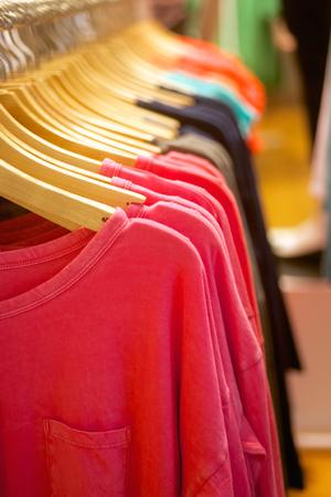 fashion wozmen s t-shirts hanging in trendy boutique photo