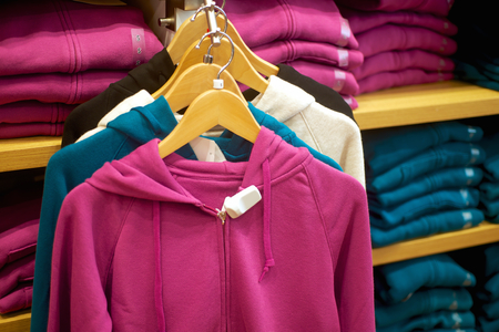 sweats: fashion woman s  sweats hoodie hanging in trendy boutique