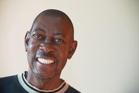 Portrait of an elderly African cheerful men