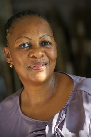 Portrait of an cheerful African worker woman indoor