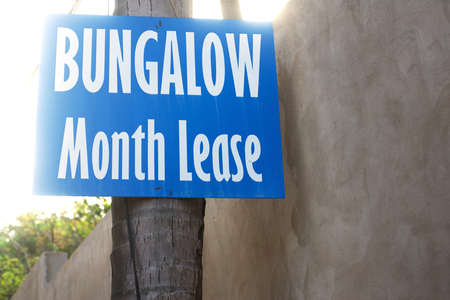 timeshare: Bungalow month lease information in tropical beach Stock Photo