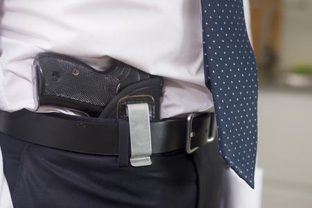 gangster with gun: Bodyguard with gun indoor home