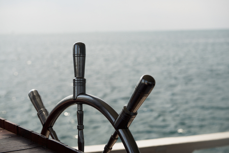 captain ship: One metal steering wheel the boat