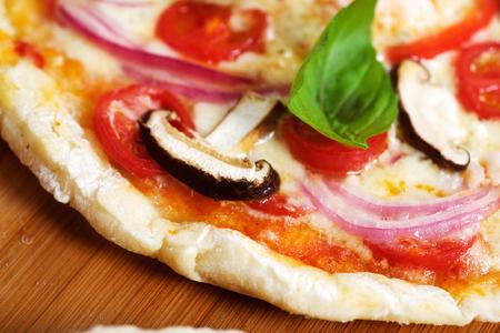 margarita pizza: Vegeterian margarita pizza close up photo.