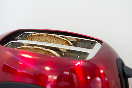 reg: Two plates of bread in the modern reg toaster