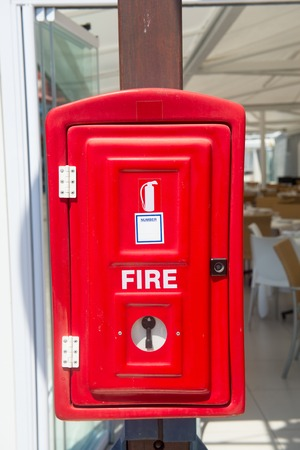 Red fire box on the town street, old England style Stock Photo