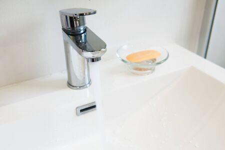 modern bathroom: Modern water tap in white bathroom Stock Photo