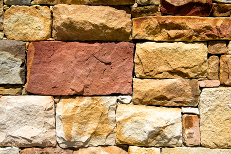 bakground: The big stones wall yellow color bakground Stock Photo