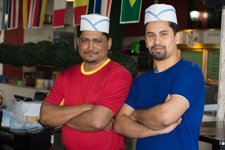 employers: Portrait of two cooks Asian cafe employers Stock Photo