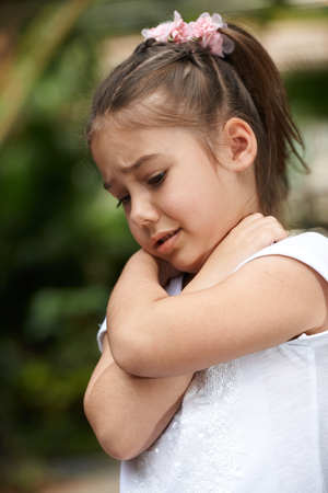 sodden: Little girl crying and hug self by hands emotion outdoor photo