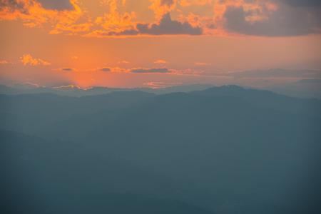 Sunset with golden sky and Asian mountain views Standard-Bild - 92948013