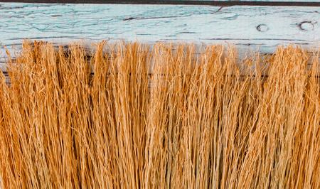 Twigs broom on a wooden board background closeup photo Standard-Bild - 93378048