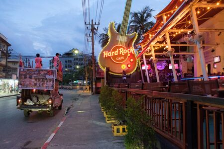 PATONG, THAILAND - 02 JUNE 2018: Hard Rock Cafe and a passing car with Thai boxing advertising