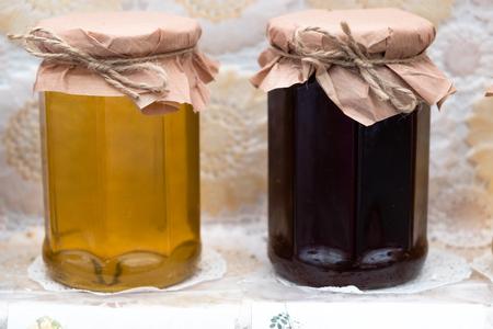 Two jars with fresh honey closeup photo Standard-Bild - 108230314
