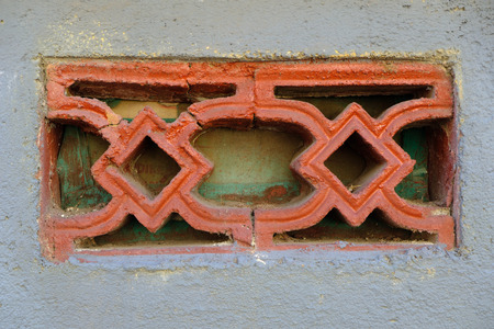 Decorative details of the wall of the old buildings of the Indonesian island of Bali Standard-Bild - 108230318
