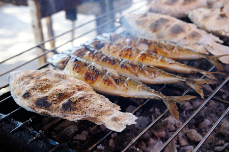 Tilapia in salt on the coals is a traditional Thai dish