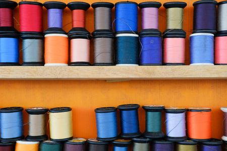 colored threads on a tailors shelf