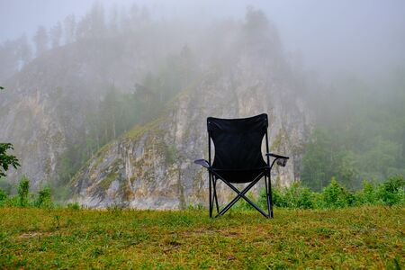 Chair on the mountain to observe the fog Banco de Imagens