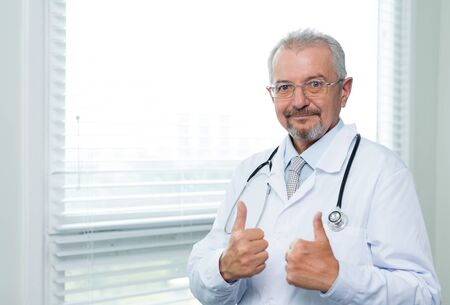 Doctor showing thumbs up satisfaction sign