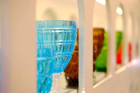 Shelf of a modern store with a decorative vase of glass