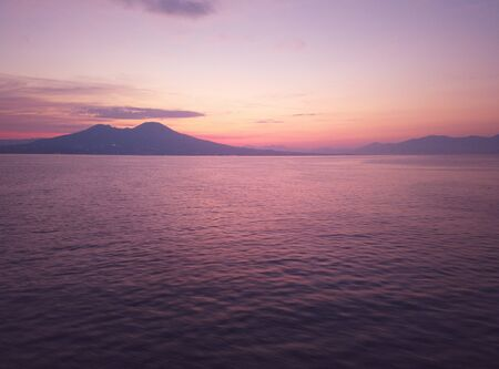 View of Naples city from the sea at sunrise Banco de Imagens