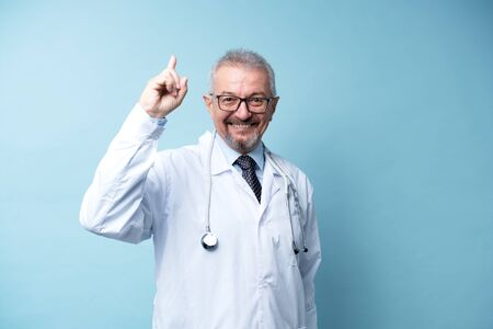Caucasian adult happy doctor smiling and pointing