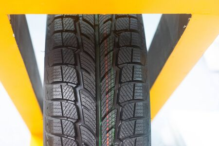 Modern tire at a car show stand Imagens