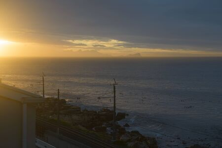 Atlantic ocean at sunset. The view from the window of a South African house Banco de Imagens