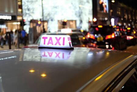 Evening time taxi in Hong Kong Banco de Imagens - 148615332