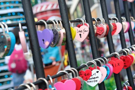 Lots of locks with an inscription of love in a row Standard-Bild