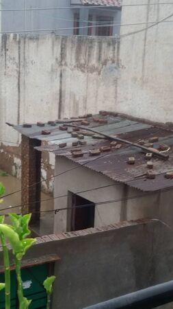 poor man: hut of poor man : urban poverty
