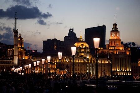 View on Shanghai Bund with street lamps in the dusk