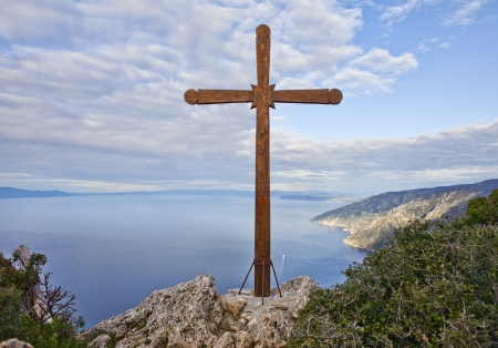 Wooden Cross on a rock on Mount Athos above the sea, Greece