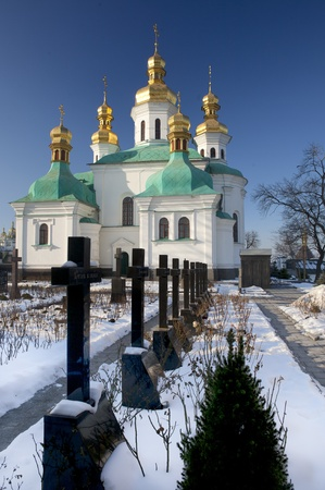 Churchyard in Kiev-Pechersk Lavra monastery in snow, Kiev, Ukraine photo