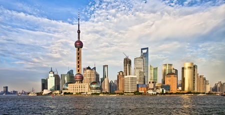 Panoramic view on modern Shanghai architecture skyline of Pudong district at sunset from the Bund on Huangpu river, China