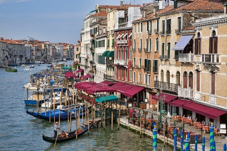 View on the Grand Canal with gondola from the Rialto bridge in Venice in the morning