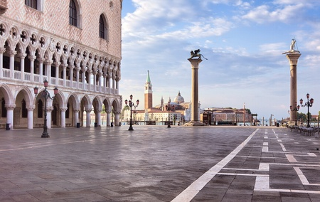 venezia: St Mark square in the first rays of sun at sunrise, Venice, Italy