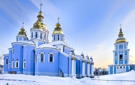 Saint Michael Gilded Orthodox cathedral in Kiev in snow, Ukraine