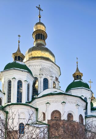 Golden domes with crosses of Saint Sophia ancient XII-th century Orthodox cathedral in Kiev, Ukraine