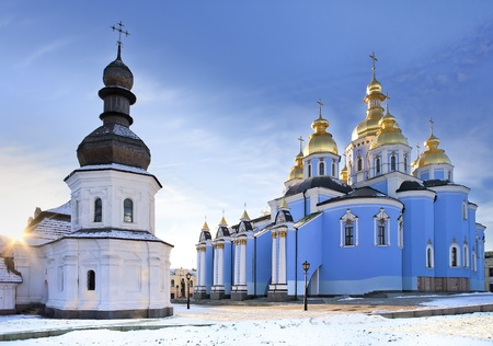 Ancient Saint Michael Gilded Orthodox cathedral and the Refectory church with wooden dome in snow, Kiev, Ukraine