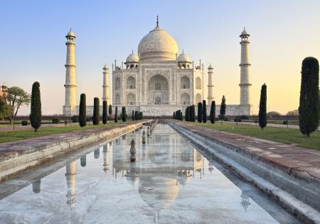 agra: Taj Mahal refected in the water at sunrise, Agra, India