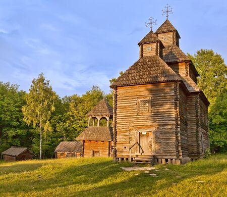 Wooden Ukrainian rural Orthodox church complex in the woods at Folk Arts museum Pirogovo in Kiev, Ukraine