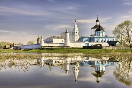 Bobrenev Russian Orthodox monastery in Kolomna near Moscow reflecting in water at flood