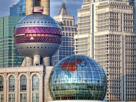 constructivism: Fragment of modern Shanghai Pudong skyline including spheres of a basement of the Oriental Pearl broadcast tower on the background of skyscrapers, seen from the Bund, China Editorial
