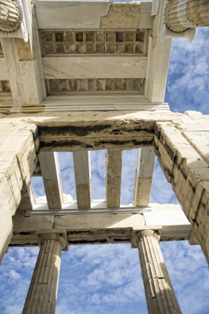 Roof of the entrance to Ancient Greek Acropolis - Propilea in the blue sky, Athens, Greece