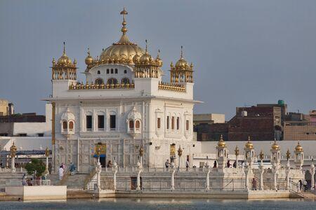 golden temple: Tarn Taran Sahib Sikh temple near Amritsar at sunset, India Editorial