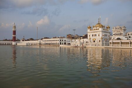 Tarn Taran Sahib Sikh temple near Amritsar at sunset, India photo
