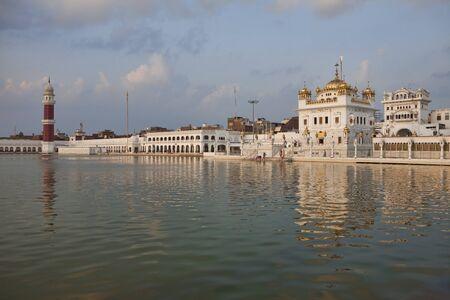 sikhism: Tarn Taran Sahib Sikh temple near Amritsar at sunset, India Stock Photo