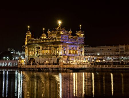 sikhism: Harmandir Sahib - Sikh Golden temple in Amritsar at night, Punjab, India