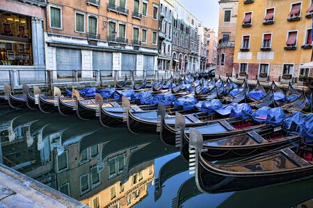 Lots of gondolas at parking in Venice near St Mark square early in the morning